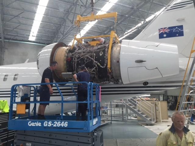 Crane Lifting Jet Engine