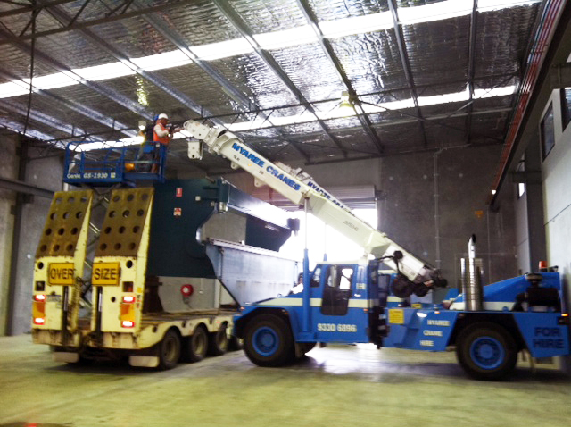 Load bender onto truck in factory